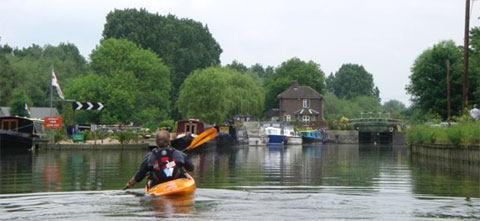 Places to kayak and canoe in London. A kayaker approaches Carthagenal Lock on the River Lea