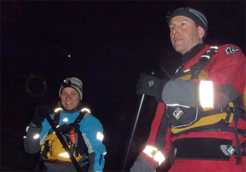 Stand Up Paddle Boarding on the River Thames in London at night