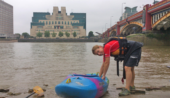 Thames kayaker opposite M16 - home to the Secret Intelligence Service and several James Bond movies.