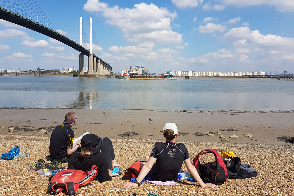 Kayaking lunch stop below the Queen Elizabeth II Bridge on Thames Estuary