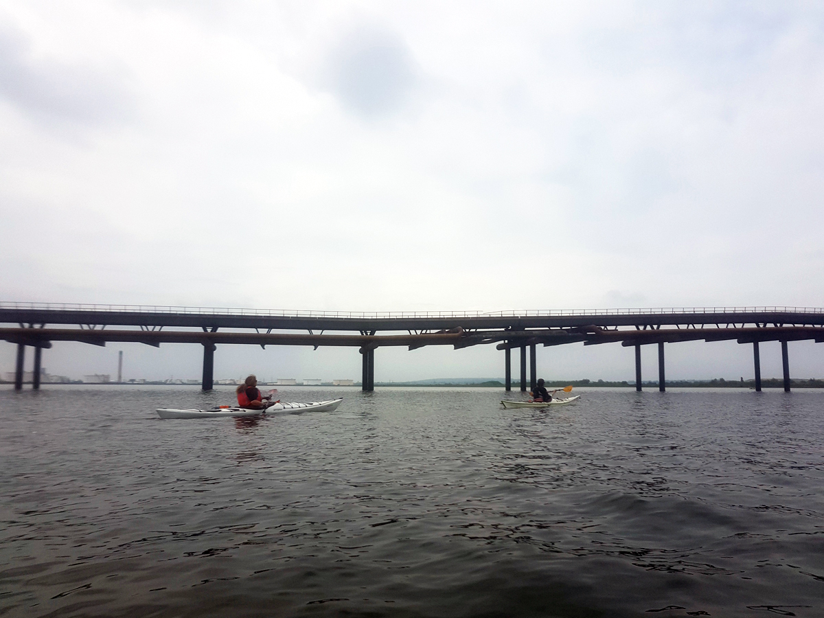 Kayaking amid petro-chemical pipelines and jetties at Canvey Island