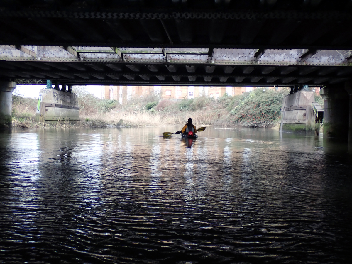 Kayaking below the Barking train bridges